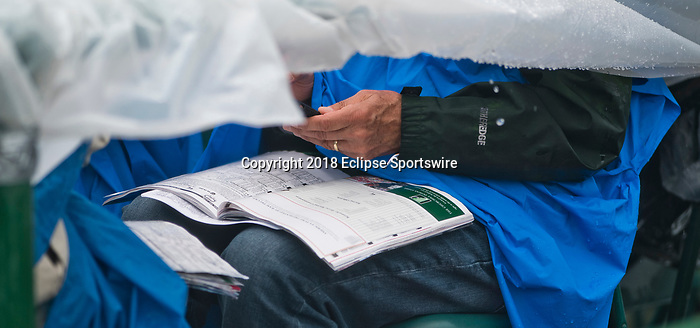 LOUISVILLE, KY - MAY 05: A man sits under a makeshift tent and reads his program on Kentucky Derby Day at Churchill Downs on May 5, 2018 in Louisville, Kentucky. (Photo by Eric Patterson/Eclipse Sportswire/Getty Images)
