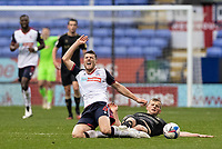 Bolton Wanderers' Ryan Delaney is fouled by Oldham Athletic's Danny Rowe (right) <br /> <br /> Photographer Andrew Kearns/CameraSport<br /> <br /> The EFL Sky Bet League Two - Bolton Wanderers v Oldham Athletic - Saturday 17th October 2020 - University of Bolton Stadium - Bolton<br /> <br /> World Copyright © 2020 CameraSport. All rights reserved. 43 Linden Ave. Countesthorpe. Leicester. England. LE8 5PG - Tel: +44 (0) 116 277 4147 - admin@camerasport.com - www.camerasport.com