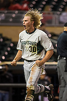 Cam Gibson (30) of the Michigan State Spartans celebrates a run during a 2015 Big Ten Conference Tournament game between the Maryland Terrapins and Michigan State Spartans at Target Field on May 20, 2015 in Minneapolis, Minnesota. (Brace Hemmelgarn/Four Seam Images)