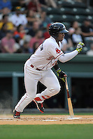 Left fielder Kyri Washington (21) of the Greenville Drive bats in a game against the Columbia Fireflies on Thursday, April 21, 2016, at Fluor Field at the West End in Greenville, South Carolina. Columbia won, 13-9. (Tom Priddy/Four Seam Images)