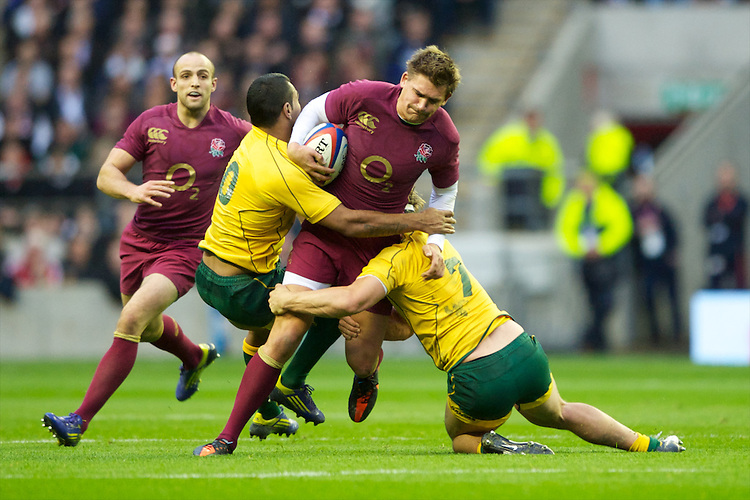 Toby Flood of England is tackled by Kurtley Beale (left) and Michael Hooper of Australia during the Cook Cup between England and Australia, part of the QBE International series, at Twickenham on Saturday 17th November 2012 (Photo by Rob Munro)