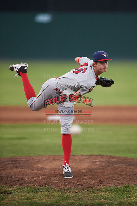 Auburn Doubledays relief pitcher Jackson Tetreault (45) follows through on a warmup pitch during a game against the Batavia Muckdogs on July 6, 2017 at Dwyer Stadium in Batavia, New York.  Auburn defeated Batavia 4-3.  (Mike Janes/Four Seam Images)