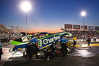 Sep 27, 2013; Madison, IL, USA; NHRA funny car driver Tony Pedregon is pushed into the water box by crew members during qualifying for the Midwest Nationals at Gateway Motorsports Park. Mandatory Credit: Mark J. Rebilas-