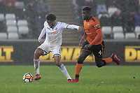 (L-R) Leroy Fer of Swansea City chased by Alfred N'Diaye of Wolverhampton Wanderers during the Emirates FA Cup match between Swansea and Wolverhampton Wanderers at the Liberty Stadium, Swansea, Wales, UK. Wednesday 17 January 2018