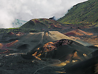 Because of the high elevation of HALEAKALA NATIONAL PARK on Maui in Hawai, cinder cones are often seen amongst cloudsi