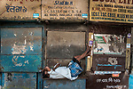 A man sleeps in the afternoon on the bench of a book store at a lane in college street in Kolkata. College street is the largest book market in the country and is one of the most important and recognised places in the city. India is going through the 2nd phase of lockdown due to covid 19 pandemic. This is to curb the spread of Covid 19 in the country. The second phase is handled with more strict rules by the administration. Kolkata, West Bengal, India. Arindam Mukherjee.