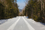 Elbow Pond Road in Woodstock, New Hampshire after a dusting of snow. This is a seasonal road that is closed during the winter months. And it follows the old railroad bed of the Elbow Pond Branch of the Gordon Pond Railroad (1907-1916).