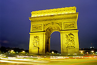 Paris, Arc de Triomphe, France, Europe, Arc de Triomphe at Place Charles de Gaulle illuminated at night in Paris. Headlights of traffic passing around the base of the arc.