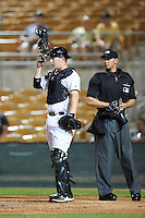 Glendale Desert Dogs Zack Collins (18), of the Chicago White Sox organization, and umpire Travis Eggert during a game against the Salt River Rafters on October 19, 2016 at Camelback Ranch in Glendale, Arizona.  Salt River defeated Glendale 4-2.  (Mike Janes/Four Seam Images)