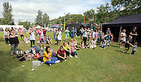 Pictured: People watch a performance on stage Saturday 13 August 2016<br />