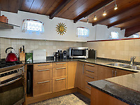 BNPS.co.uk (01202) 558833. <br /> Pic: Zeewarriors/BNPS<br /> <br /> Pictured: Kitchen. <br /> <br /> A 100-year old Dutch sailing barge moored in Bermondsey has gone on sale for £278,000.<br /> <br /> The 25-metre MV Johanna Elisabeth was originally constructed in 1913 at Appelo, Zwartsluis in Holland, and was brought to the UK in 2003 by a previous owner.<br /> <br /> Her work as a sailing barge included shipping freight but she is now moored at the South Dock Marina in Bermondsey, south London, and used as a home.