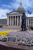 "Oklahoma City, Oklahoma, USA.  State Capitol Building, front, with statue ""As Long as the Waters Flow"", by Allan Houser, a Chiracahua Apache Sculptor."