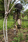 Munda, Western Province, Solomon Islands; helmets and canteens decorate the fence at the Peter Joseph World War II Museum, named by the owner, Barry, after the soldier on the first dog tag with which he began his collection