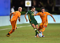 LAKE BUENA VISTA, FL - JULY 18: Diego Valeri #8 of the Portland Timbers passes the ball away from pressure by Zarek Valentin #4 of the Houston Dynamo and  Aljaz Struna #5 of the Houston Dynamo during a game between Houston Dynamo and Portland Timbers at ESPN Wide World of Sports on July 18, 2020 in Lake Buena Vista, Florida.