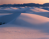 Sunset light and reflected color on sand dunes; White Sands National Monument, NM