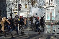 Protesters fight  throwing paving stones towards the police. Kiev, Ukraine