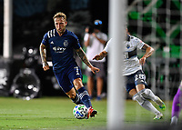 LAKE BUENA VISTA, FL - JULY 26: Johnny Russel of Sporting KC cuts inside during a game between Vancouver Whitecaps and Sporting Kansas City at ESPN Wide World of Sports on July 26, 2020 in Lake Buena Vista, Florida.