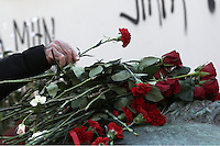 Pictured: A man leaves a red carnation at the monument for the uprising at the Athens Polytechnic in Athens Greece. Thursday 17 November 2016<br /> Re: 43rd anniversary of the Athens Polytechnic uprising of 1973 which was a massive demonstration of popular rejection of the Greek military junta of 1967–1974. The uprising began on November 14, 1973, escalated to an open anti-junta revolt and ended in bloodshed in the early morning of November 17 after a series of events starting with a tank crashing through the gates of the Polytechnic.