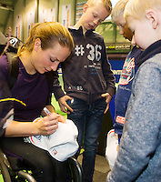 22-12-13,Netherlands, Rotterdam,  Topsportcentrum, Tennis Masters, Wheelchair final, Jiske Griffioen(NED)   wins the Masters(R) and signs autographs<br /> Photo: Henk Koster