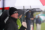 3 October 2008: Brad Elder hides under an umbrella during a hail storm at the Turning Stone Golf Championship in Verona, New York during the second round.