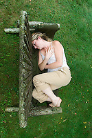 Blonde woman sitting on bench<br />