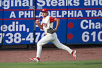 Clearwater Threshers outfielder Andrew Pullin (17) chases down a ball during the first game of a doubleheader against the Jupiter Hammerheads on July 25, 2015 at Bright House Field in Clearwater, Florida.  Jupiter defeated Clearwater 8-5.  (Mike Janes/Four Seam Images)