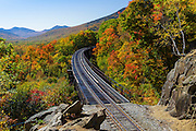 Crawford Notch State Park - Frankenstein Trestle along the old Maine Central Railroad in the Hart's Location, New Hampshire USA during the autumn months. The trestle you see today was built in 1893 to replace the original wrought iron trestle built in 1875. Since 1995 the Conway Scenic Railroad, which provides passenger excursion trains has been using the track.