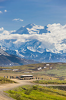 Tourists view the summit of Denali from Stony Dome, in Denali National Park, Interior, Alaska.