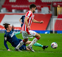 20th March 2021; Bet365 Stadium, Stoke, Staffordshire, England; English Football League Championship Football, Stoke City versus Derby County; Max Bird of Derby County tackles Tommy Smith of Stoke City