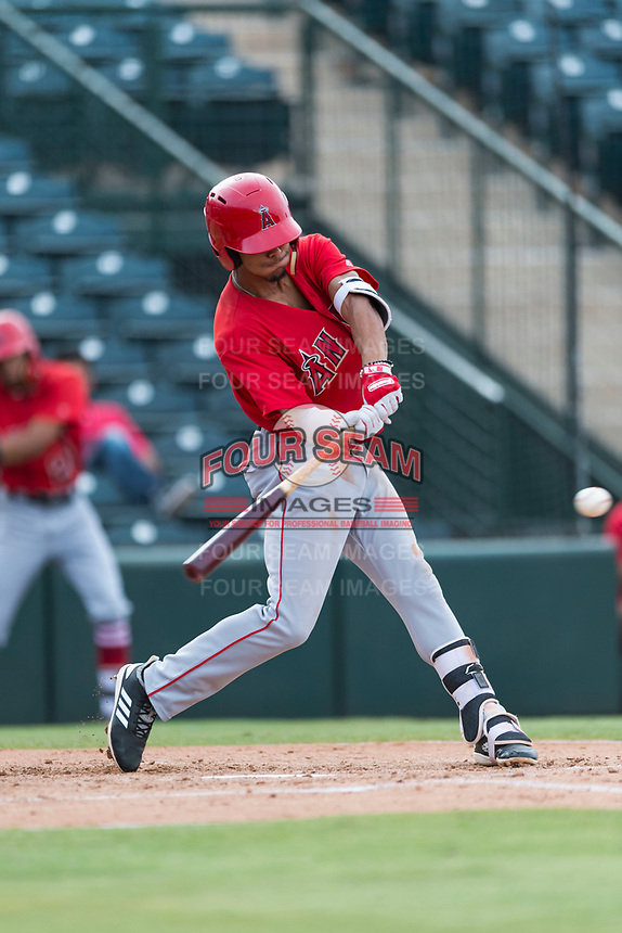 AZL Angels shortstop Jeremiah Jackson (8) swings at a pitch during an Arizona League game against the AZL Diamondbacks at Tempe Diablo Stadium on July 16, 2018 in Tempe, Arizona. The AZL Diamondbacks defeated the AZL Angels by a score of 4-3. (Zachary Lucy/Four Seam Images)