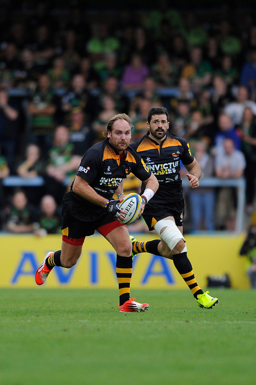Andy Goode of Wasps makes a break during the Premiership Rugby Round 2 match between Wasps and Northampton Saints at Adams Park on Sunday 14th September 2014 (Photo by Rob Munro)