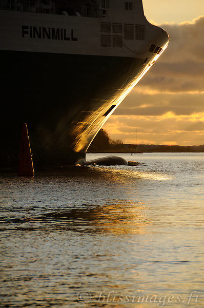 Finnline's bow is backlit with golden light