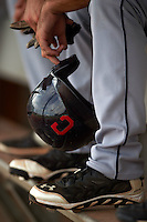 Cleveland Indians player holding a batting helmet in the dugout during an instructional league game against the Los Angeles Dodgers on October 15, 2015 at the Goodyear Ballpark Complex in Goodyear, Arizona.  (Mike Janes/Four Seam Images)