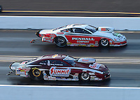 Jul. 1, 2012; Joliet, IL, USA: NHRA pro stock driver Greg Anderson (near lane) races alongside Mike Edwards during the Route 66 Nationals at Route 66 Raceway. Mandatory Credit: Mark J. Rebilas-