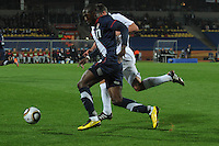 U.S. forward Jozy Altidore skates past England defender Jamie Carragher during the team's debut match in the 2010 FIFA World Cup. The U.S. and England played to a 1-1 draw in the opening match of Group C play at Rustenburg's Royal Bafokeng Stadium, Saturday, June 12th.