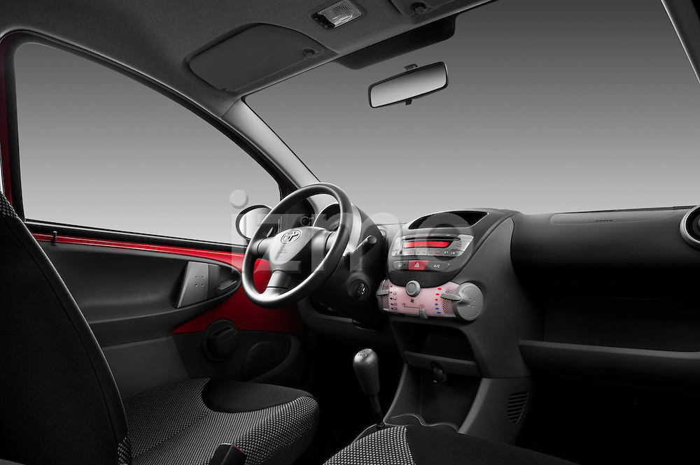 Passenger side dashboard view of a 2010 Toyota Aygo + 5 Door Microcar .