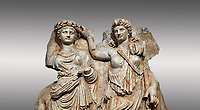 Close up of a Roman Sebasteion relief  sculpture of Aphrodite crowned by Andreia, Aphrodisias Museum, Aphrodisias, Turkey. <br /> <br /> A draped goddess is crowned by a female warrior figure. The goddess is probably Aphrodite, while the warrior has a bare breated Amazonian dress and equipment (spear, sword strap and shield) worn by Roma or Andreia (Bravery)