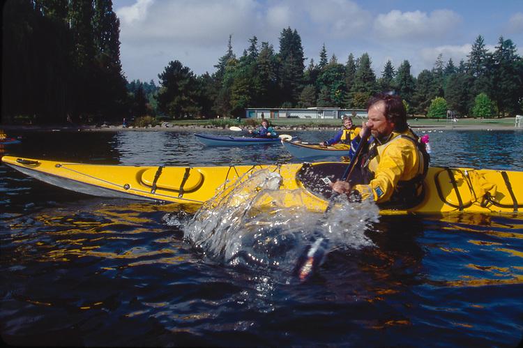 Sea kayaking, instructor in low brace, class demonstration, Seattle, Washington, Pacific Northwest, USA,
