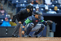 Gwinnett Braves catcher Alex Jackson (25) frames a pitch as home plate umpire Mike Wiseman looks on during the game against the Durham Bulls at Durham Bulls Athletic Park on April 20, 2019 in Durham, North Carolina. The Bulls defeated the Braves 11-3 in game one of a double-header. (Brian Westerholt/Four Seam Images)