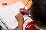K-8 Parochial School Bronx New York Grade 3 mathematics lesson on measurement girl using ruler at desk horizontal