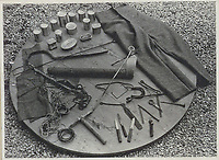 BNPS.co.uk (01202 558833)<br /> Pic: IronCrossMagazine/BNPS<br /> <br /> Pictured: Tools used to dig the tunnels.<br /> <br /> The comical escape attempts made by British officers from a German prisoner of war camp called Castle Tittmoning have been revealed 80 years later.<br /> <br /> The desperate efforts to break out of the little known but rude sounding camp included three men who hid inside a cramped fireplace for eight days before being found by guards covered in soot.<br /> <br /> Other officers hid under piles of rubbish on a horse-drawn cart and allowed themselves to be driven out of the fortress before they were discovered.<br /> <br /> The men expertly made German uniforms out of blankets and brazenly walked out of the camp disguised as guards before being rumbled.