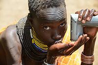 ETHIOPIA, Southern Nations, Lower Omo valley, Kangaten, village Kakuta, Nyangatom tribe, water pump at dry river Kibisch / AETHIOPIEN, Omo Tal, Kangaten, Dorf Kakuta, Nyangatom Hirtenvolk, Wasserpumpe am trocknen Fluss Kibish