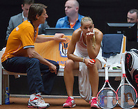 The Netherlands, Den Bosch, 16.04.2014. Fed Cup Netherlands-Japan, Disapointment after loosing the first match, Aranxta Rus on the Dutch Bench with captain Paul Haarhuis<br /> Photo:Tennisimages/Henk Koster