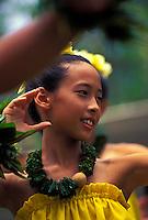 Young girl dancing hula at an outdoor setting