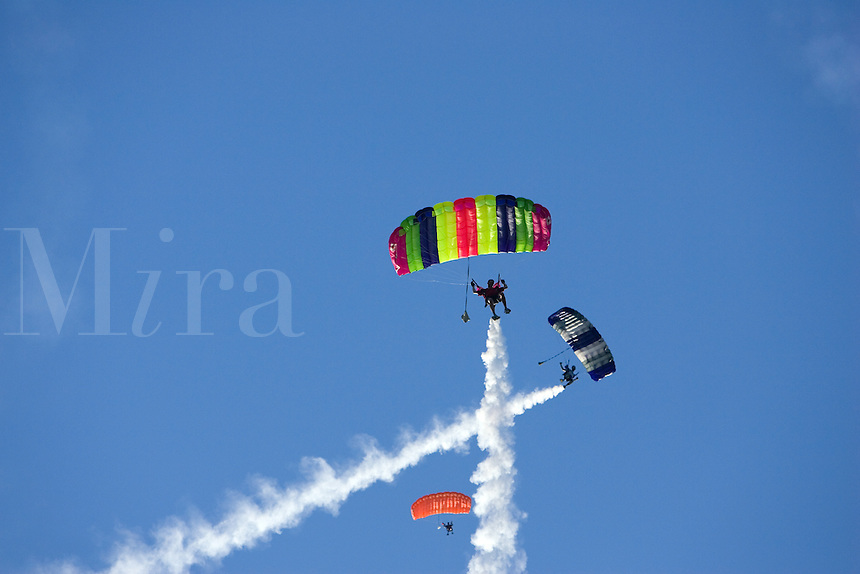 Sky Divers with smoke trails