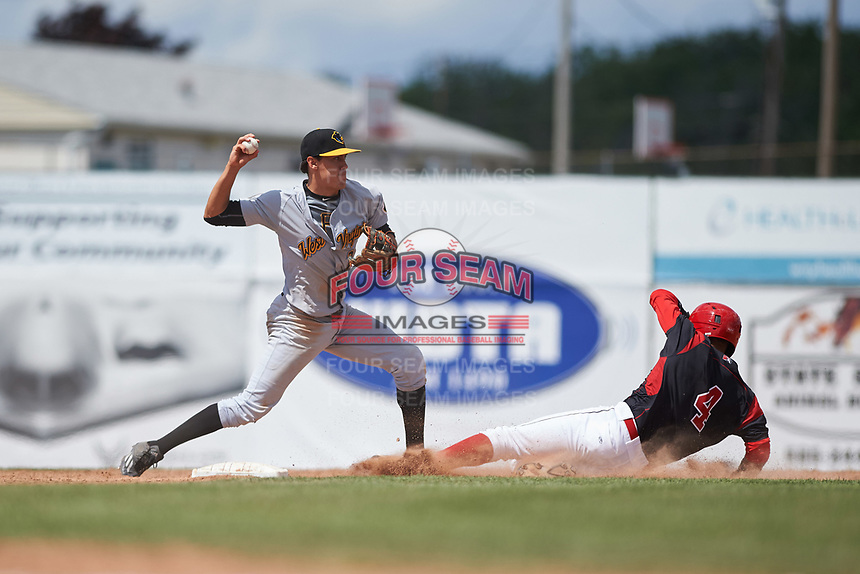 West Virginia Black Bears second baseman Tristan Gray (2) throws to first base after forcing out J.C. Millan (4) on a double play attempt during a game against the Batavia Muckdogs on June 25, 2017 at Dwyer Stadium in Batavia, New York.  West Virginia defeated Batavia 6-4 in the completion of the game started on June 24th.  (Mike Janes/Four Seam Images)