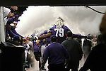 Ben Ossai (#79), of the University of Washington,  comes out of the tunnel prior to the start of the 2009 Apple Cup football game with the Washington State Cougars on November 28, 2009.