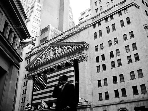 New York, New York <br /> USA<br /> October 2008<br /> <br /> A man on his phone in front of Wall Street in New York.