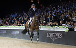 Marco Kutscher riding Van Gogh, Kevin Staut riding For Joy van't Zorgvliet HDC and Emanuele Gaudiano riding Caspar 232 celebrate at the podium after Kutscher,s victory  at the Longines Grand Prix, part of the Longines Masters of Hong Kong on 21 February 2016 at the Asia World Expo in Hong Kong, China. Photo by Victor Fraile / Power Sport Images
