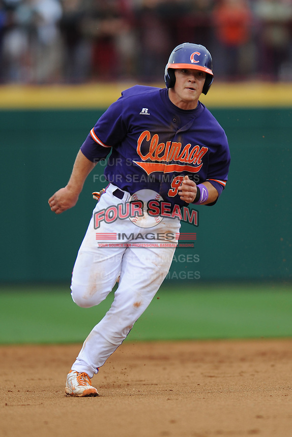 Catcher Phil Pohl #9 of the Clemson Tigers on his way to third during a game against the South Carolina Gamecocks at Carolina Stadium on March 3, 2012 in Columbia, South Carolina. The Gamecocks defeated the Tigers 9-6. Tony Farlow/Four Seam Images.
